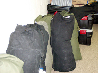 Ten packed duffle bags
