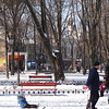 church steeple visible from City Park on Deribasovskaya St. in snow - man sledding with child