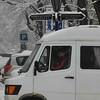 snowy street sign, van