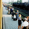 people waiting for train on platform -- and vendors waiting to sell things to passengers on the Kyiv-Odessa train in mid-1990s Ukraine