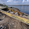 Abandoned boat, left high and dry by the receding waters of a drying-up finger lake near Odessa, Ukraine