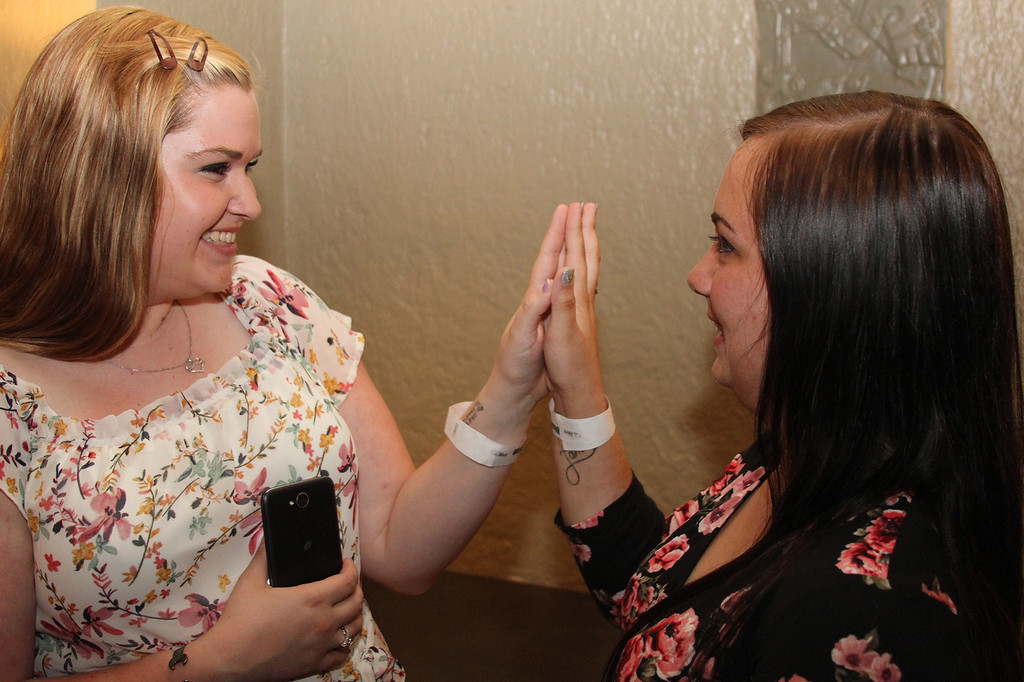 . Ulster BOCES Motorcycle/Outdoor Power/Turf Management student (left) Cassandra Woinoski and Culinary Arts student Amber VanWagenen, both from the Rondout Valley Central School District, give each other a high five moments prior to receiving their program completion certificates.