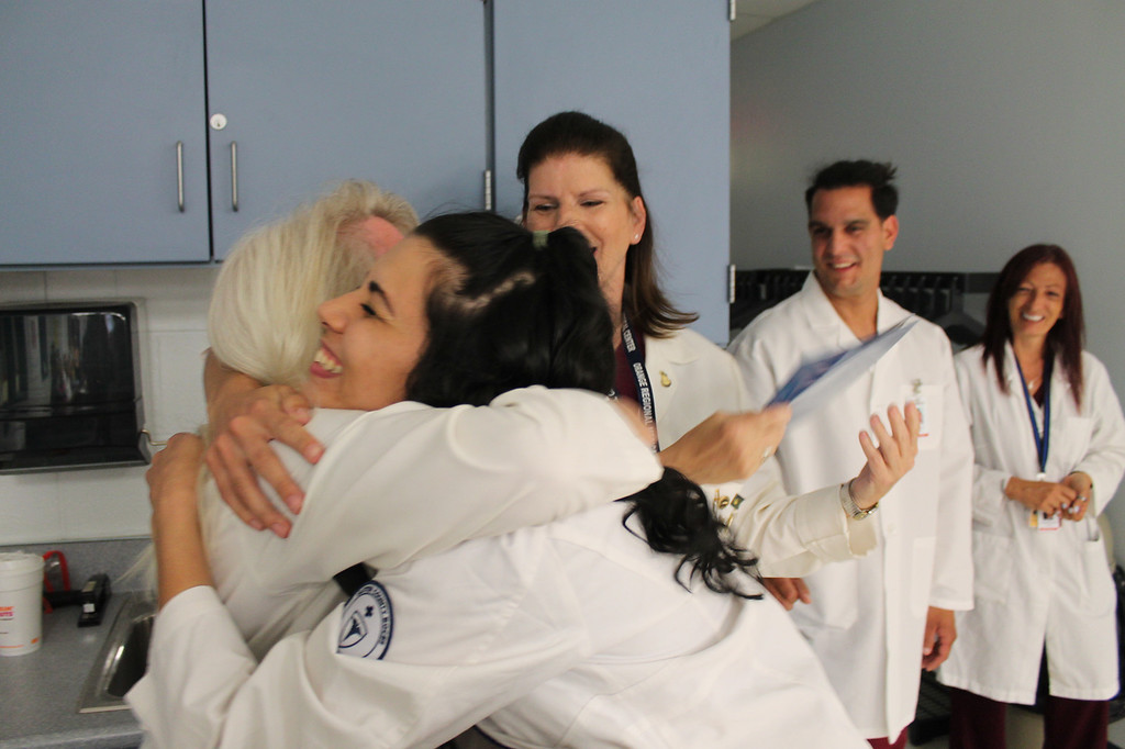 . Stephanie Harris of Kingston gets a congratulatory hug from her instructor Penny Foody at the Surgical Technologist graduation ceremony. The ceremony was held Thursday at the Ulster BOCES Adult Career Education Center in Port Ewen.