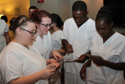 Ulster BOCES Adult Career Education Center's School of Practical Nursing students (L-R) Paula Williams of Kingston, Kashmir Gallagher of Red Hook, Stewart Bullock of Kingston, and Robina Njoroge of Cortlandt Manor read over their thank you cards prior to the commencement ceremony.