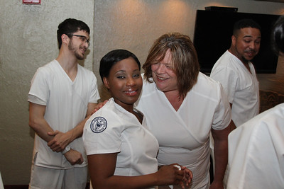 Ulster BOCES Adult Career Education Center's School of Practical Nursing students Cheri Scully of Glenford hugs Shanakae Paul of Hudson who was feeling emotional prior to the graduation ceremony.