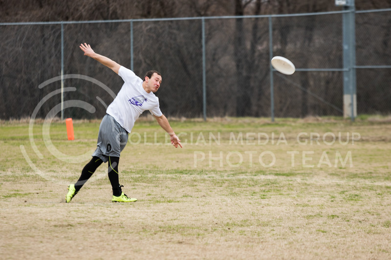 Senior in Animal Science, Nathan Witters makes a throw at the K-State Wizards' Ultimate Frisbee tournament in Denton, Texas on Feb. 4, 2017. (John Benfer | Royal Purple)