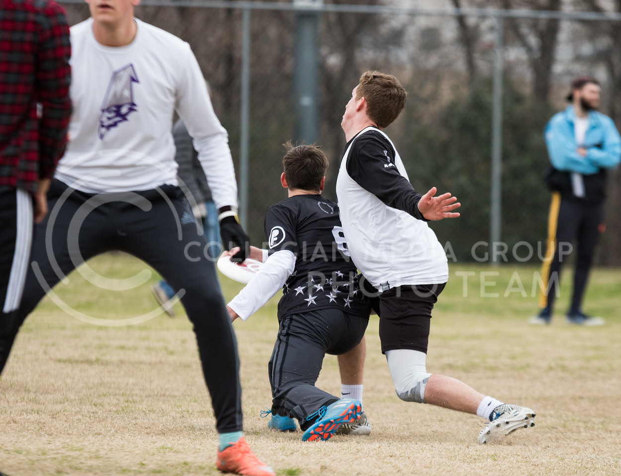 Freshman in Kinesiology, Samuel Nelson defends a thrower at the K-State Wizards' Ultimate Frisbee tournament in Denton, Texas on Feb. 4, 2017. (John Benfer | Royal Purple)