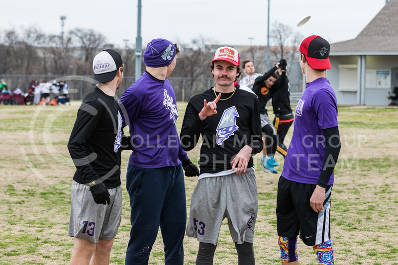 Sophomore in finance, Darien Par, freshman Josh Smith, sophomore in business, Brett Dare, and freshman in civil engineering, Erik Hjelmaas stand on the sideline  at the K-State Wizards' Ultimate Frisbee tournament in Denton, Texas on Feb. 4, 2017. (John Benfer | Royal Purple)