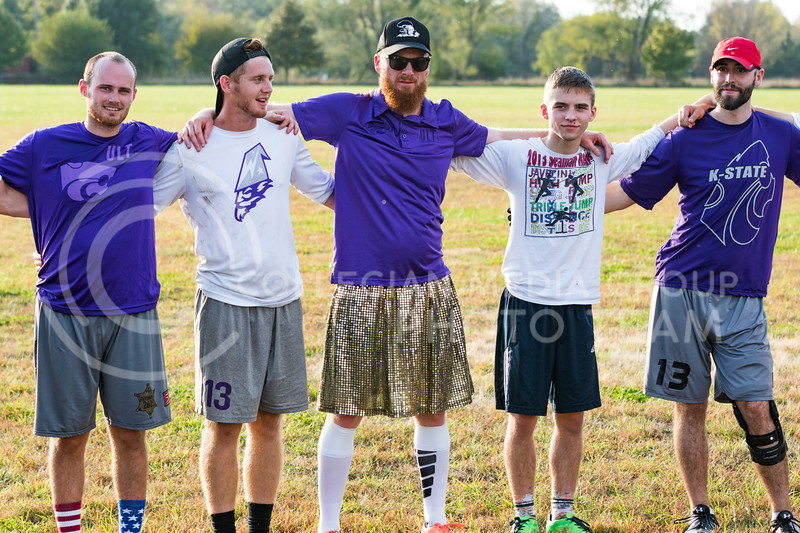K-State Wizards ultimate frisbee club members huddle with K-State Alumni team after their game in The Manhattan Project tournament in Manhattan, Kansas on Oct. 15, 2016. (John Benfer | Royal Purple)