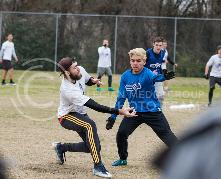 Senior treasurer Erik Neilson makes a throw at the K-State Wizards' Ultimate Frisbee tournament in Denton, Texas on Feb. 5, 2017. (John Benfer | Royal Purple)