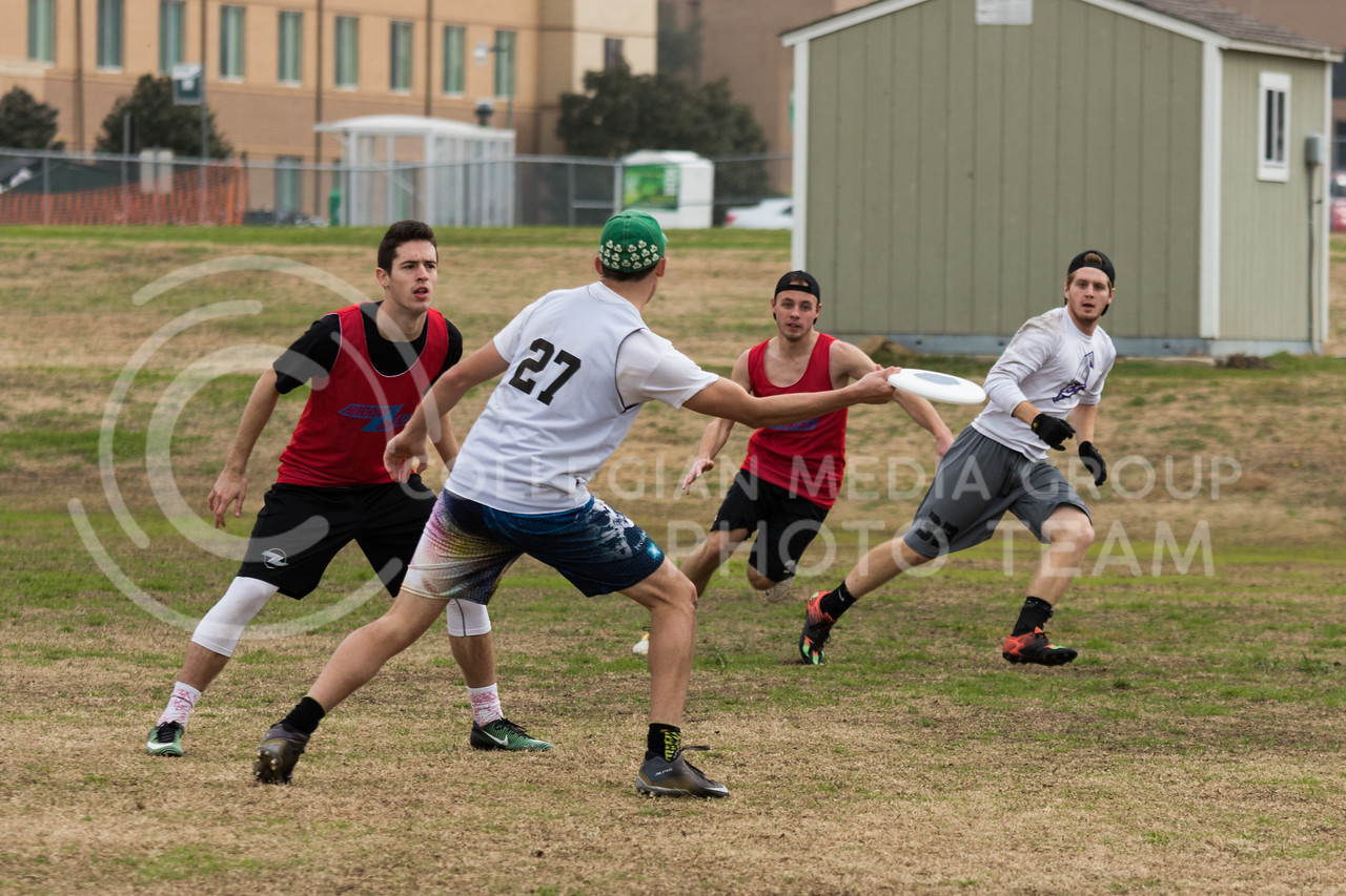 Freshman in business, Colin Beauregard fakes a throw at the K-State Wizards' Ultimate Frisbee tournament in Denton, Texas on Feb. 5, 2017. (John Benfer | Royal Purple)