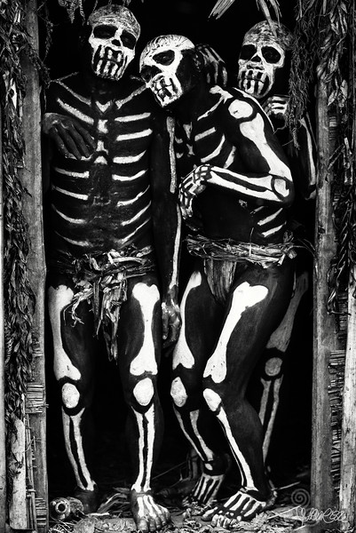 Skeleton men in doorway