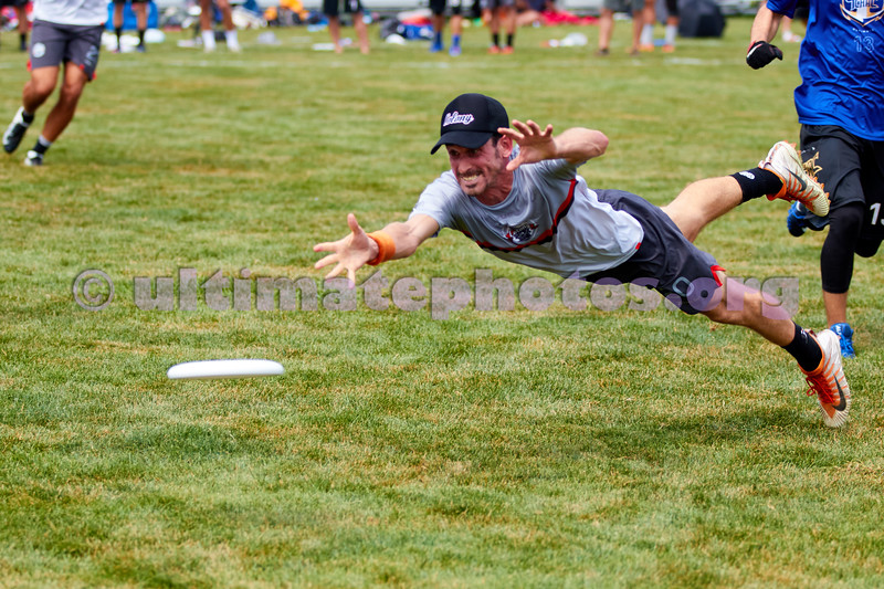 Abra Garfield, #20 Colony (AUS Men's) bids for a low disc against TCHAC (France Men's) during pool play. 2018 World Ultimate Club Championships, Lebanon Sport Complex -- 15 July 2018