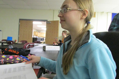 Megan watching the Smash Bros game.