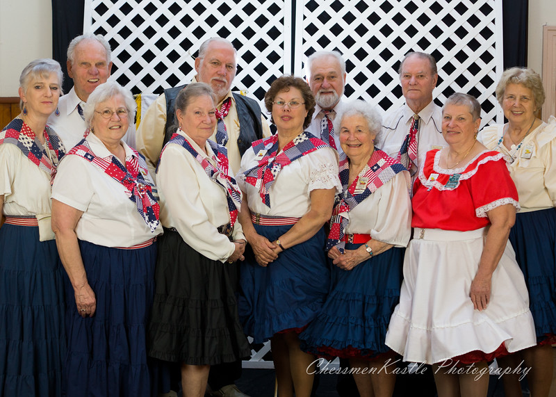 """Swinging Squares """"caravan"""" at a dance in 2015. Lorraine Kramer is in the front row (2nd from the right)."""