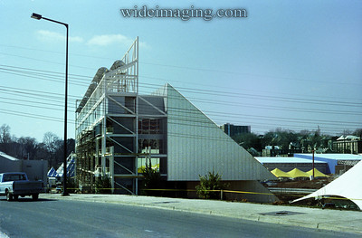 The United States Pavilion, seen here around March 1982, the World's Fair site still under construction with yellow caution tape surrounding the building. In 1991 the City of Knoxville demolished the building in a controlled blast with no use for the abandonded building found in 9 years.