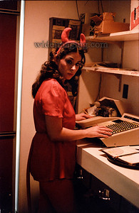 Devil in Disguise: Halloween 1982, waitress tallies up a check at the Sunsphere Restaurant.