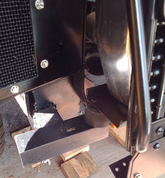 Radiator mount welded onto the front of the S-10 frame and a cut down universal suspension bumper worked out fine.