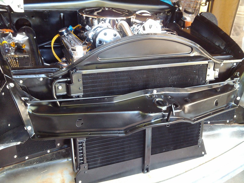 UPDATE - 7/18/2018:  Notice how much of the condenser/radiator is above the rear edge of the hood latch bracket. After this picture was taken I mounted four Cadillac mid 80s four tone horns on that flange at the back of the bracket, blocking some air flow to the top of the condenser and radiator.! Scroll down below to see what I did to fix my cooling problems..