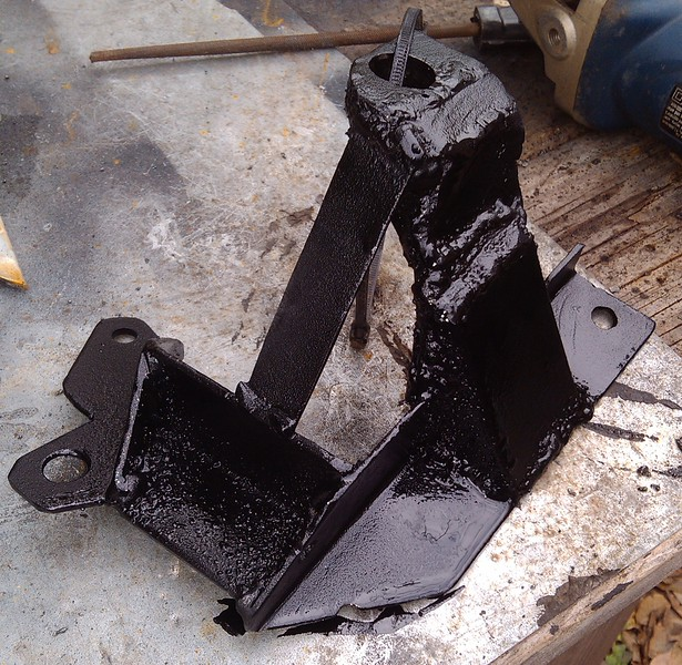 All welded up, yea, ugly, but what the heck. Sandblasted and painted. And now VERY STIFF.