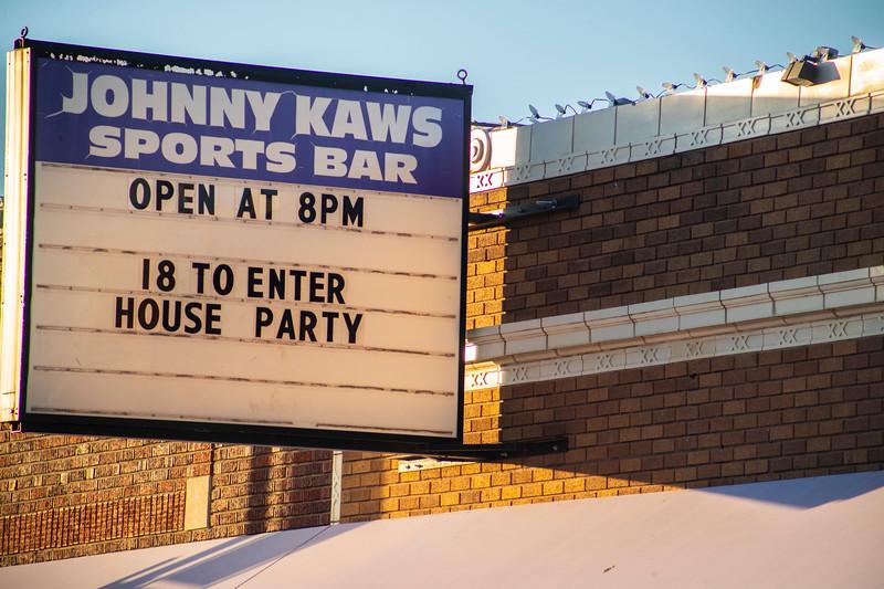 Johnny Kaws Sports Bar sign in Aggieville on November 18th 2019 (Dalton Wainscott I Collegian Media Group)
