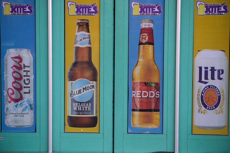 different types of alcohol in KITE's Bar window in Aggieville on November 18th 2019 (Dalton Wainscott I Collegian Media Group)