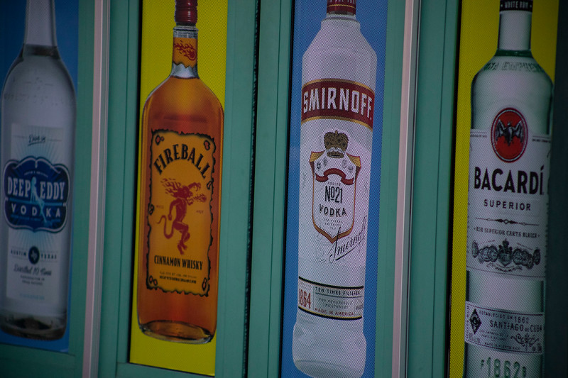 different types of alcohol on window of KITE's Bar in Aggieville on November 18th 2019 (Dalton Wainscott I Collegian Media Group)