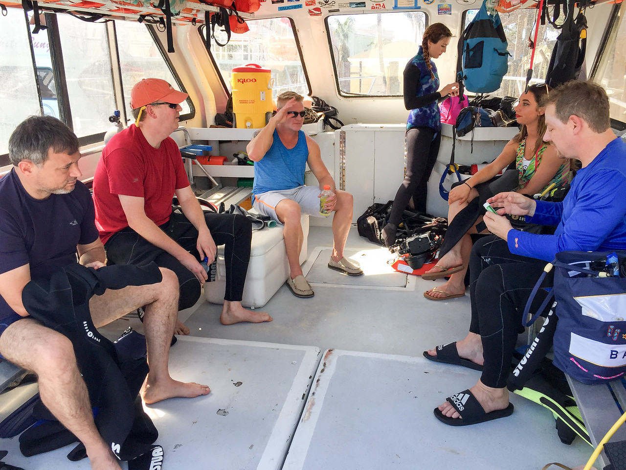 Divers discussing upcoming shark dive in Nassau, Bahamas - February 2017