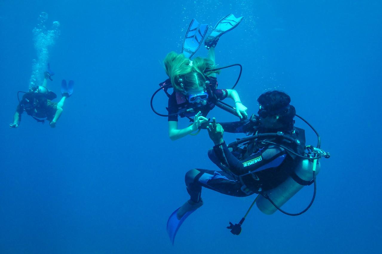 Scuba Cancun divemaster assisting diver - November 2011