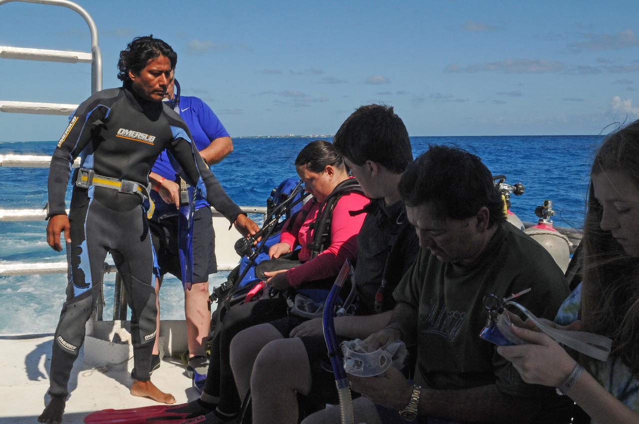 Scuba Cancun divemaster checking gear - November 2011
