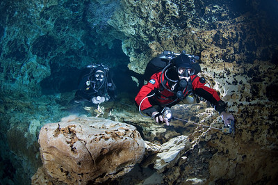 Larry and Debra Green demonstrate the proper use of a cave diving reel while maintaining excellent buoyancy control that contributes to protecting the cave environment.