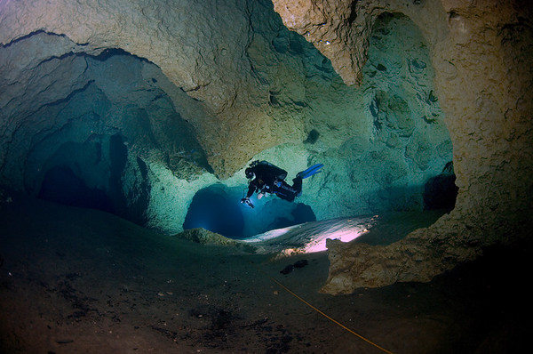 A diver floats effortlessly in the clear water of the cave at Peacock One at Peacock Springs State Park near Luraville Florida.