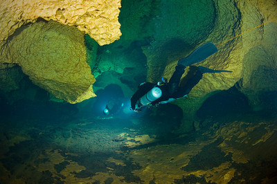 Two side mount cave divers explore the depths of Black Lagoon at Hart Springs in Gilchrist County, Florida.
