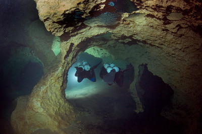 Two divers explore the tunnels inside Peacock One at Peacock Springs State Park near Luraville, Florida. Photographer Jill Heinerth captures their departure in to the watery labyrinths.