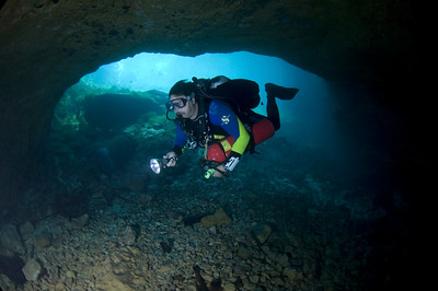 George Rice enters the cavern zone at Madison Blue Springs State Park in North Florida.