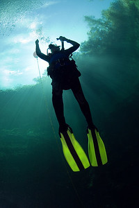 A diver ascends after diving in the clear waters of Troy Springs State Park near Branford, Florida.