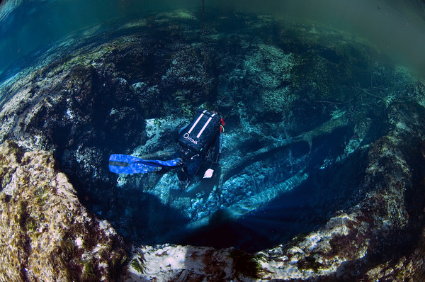 A rebreather diver pauses momentarily before entering the cave at Devil's Ear Spring, Ginnie Springs, Florida.