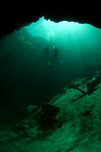 Two divers ascend from the emerald depths of Troy Spring on the edge of the Suwannee River in Branford, Florida.