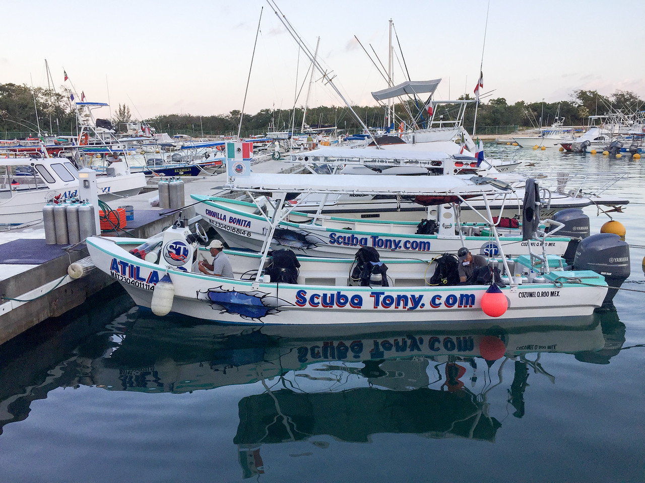 ScubaTony Cozumel boats prepping for morning dives - Cozumel, Mexico - March 2016