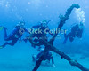 "Our group of divers explore the anchors left from the sailing ships that sank at the anchorage now called ""double wreck.""  St. Eustatius (Statia), Netherlands Antilles. (Rick is on the left side.)<br /> <br /> <br /> <br /> <br /> ""St. Eustatius"" ""Saint Eustatius"" Statia Netherlands Antilles ""Lesser Antilles"" Caribbean underwater diving ocean SCUBA dive diver divers sand bottom seabed sea floor anchor anchors wreck wrecks"