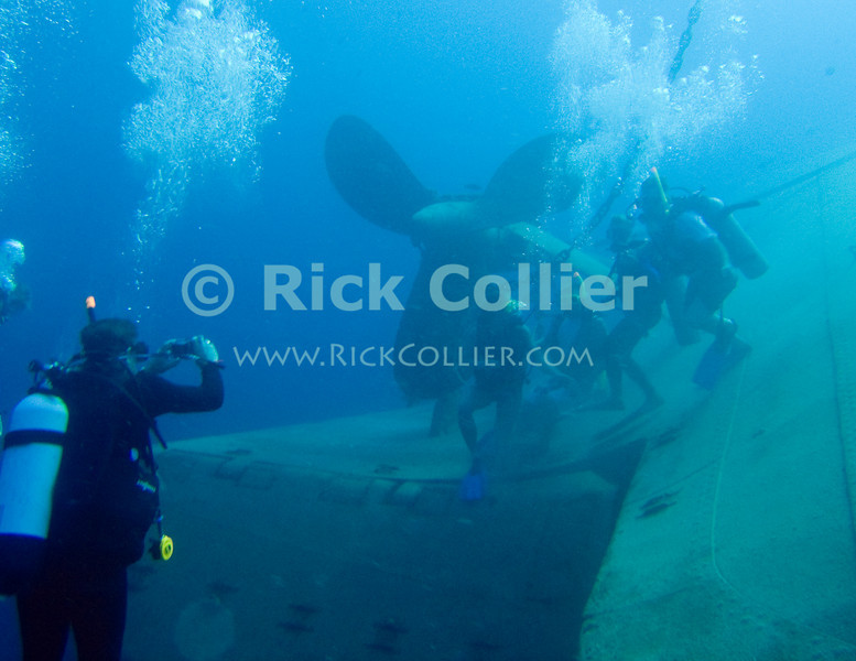 St. Eustatius (Statia) Underwater - A family of scuba divers arrange themselves for a group photo by the propeller of the Charlie Brown shipwreck.  © Rick Collier