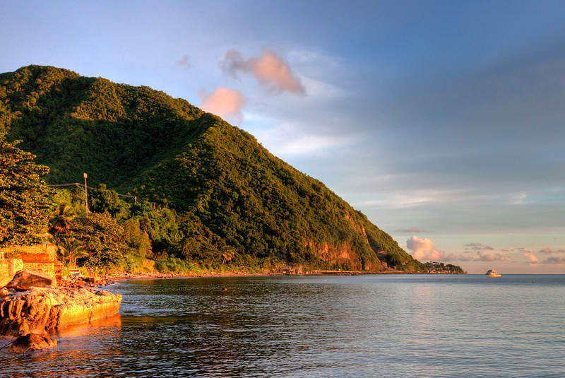 This is an HDR rendering of early evening standing on the dock of Dive Dominica looking South.