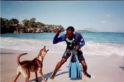 Joel Kung fu fighting with dog on beach- Sosua - april 2001