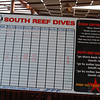 Check in and out board for unlimited dives on the wonderful housereef..