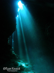 Sunbeams dancing through a cave