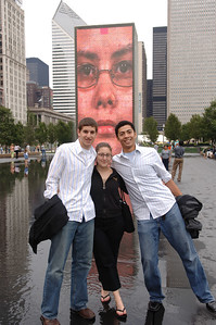 aron, rachel and dave in front of the big creepy faces in millenium park.