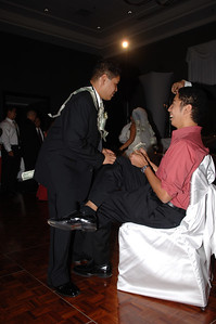 """soliciting the groom with a wad of singles during the """"money dance"""""""