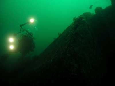 Roger Carlson Olympus 5050, Inon Wide Angle lens. 5/20 Jim Lyle on the wreck of the Avalon.