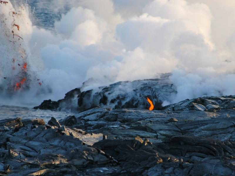 Jonathan Rodda Molten lava empties from lava tube into Pacific Ocean; explosion of steam and volcanic gases Kilauea Volcano, Big Island of Hawaii Nikon D100, Nikkor 80-400 VR lens