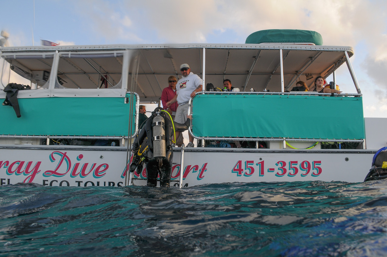 With fins in-hand, diver is boarding Amoray dive boat - Key Largo 2009